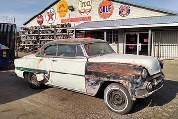 1953 Chevrolet Bel Air and vintage oil and gas signs